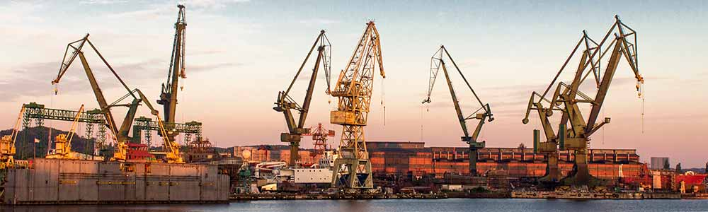 Panoramic picture of Gdansk port with cranes.