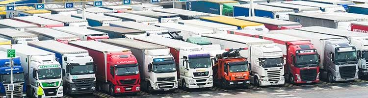 Trucks waiting in line to enter the ferry to Calais in Dover.