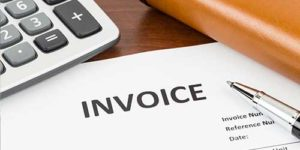 A calculator, an invoice and a pen - Commercial Invoice