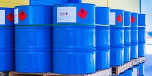 Stack of drums filled with inflammable liquid at the port - Dual-Use goods