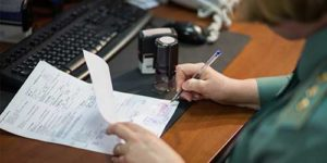 A man signing a document - EAD