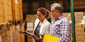 Warehouse operators taking notes on their inventory - Special Monitoring